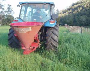 Fertilising the paddock with the spreader