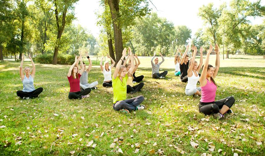 group of people practicing yoga outdoor